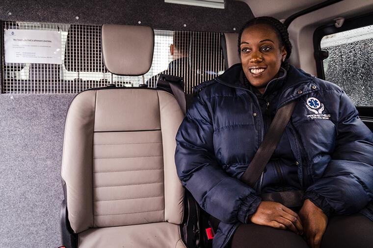Team member waiting in van